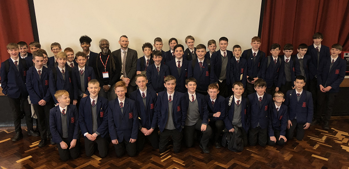 Levi Tafari with Year 9 students crop.png