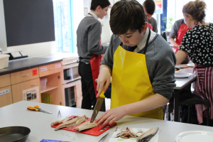 Students Learn to Fillet Fish